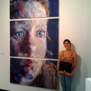 Jessica with Face and awards at SDSU Art Gallery
